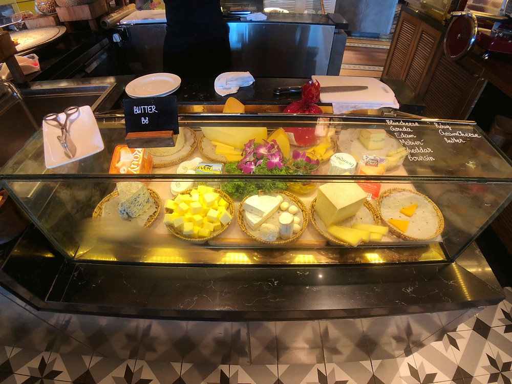 Different types of cheese available during breakfast service at Sofitel Saigon Plaza's Mezz Restaurant