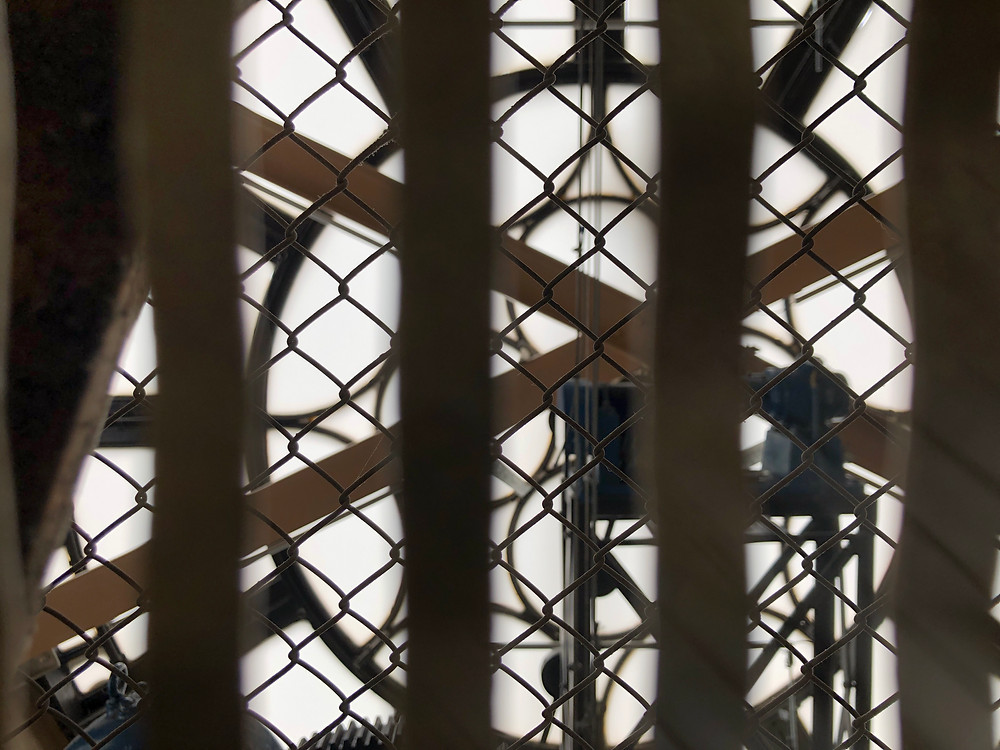Looking through the elevator at one of the faces of the Brisbane City Clock Tower