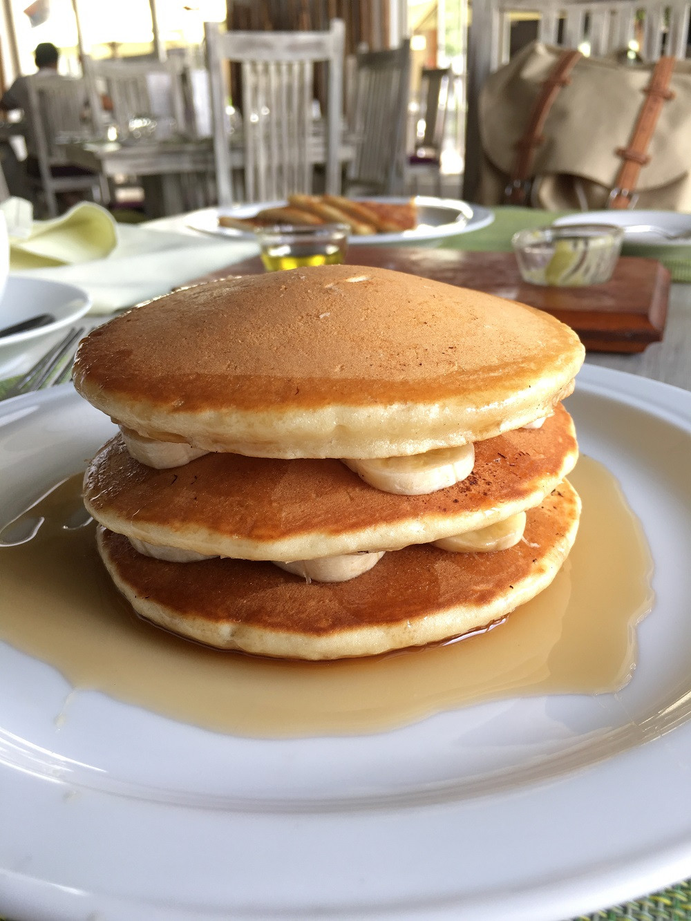 A stack of fluffy pancakes at Park Streeet Mews Restaurant