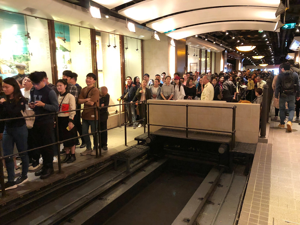 An endless crowd queues to board the Peak tram towards Victoria Peak