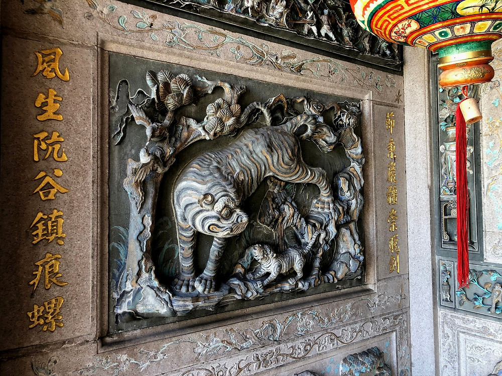 Check out the various stone carvings around the Clan House