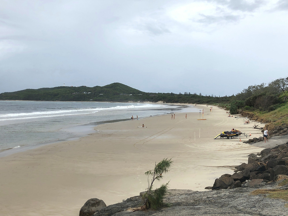 Byron Bay's Main Beach with Cape Byron Lighthouse in the background