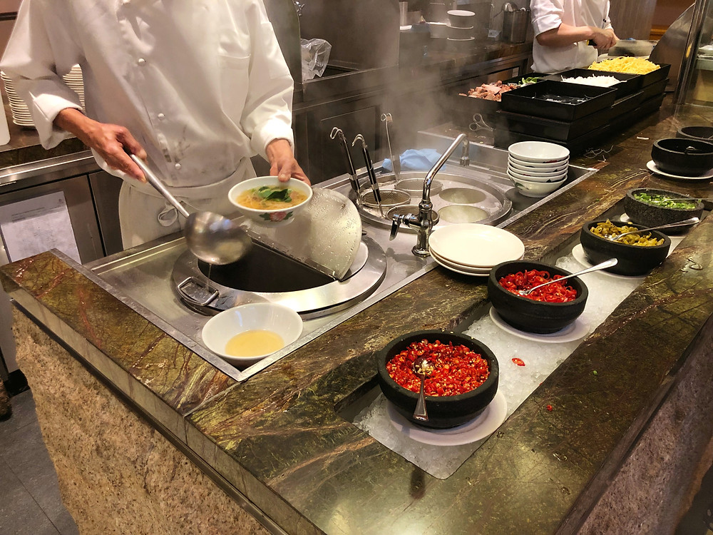 Made-to-order noodles during breakfast service at Pan Pacific Singapore's Edge