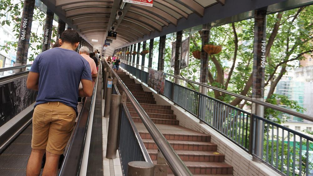 Taking the escalator up towards Mid-levels using the Central - Mid-levels escalator system