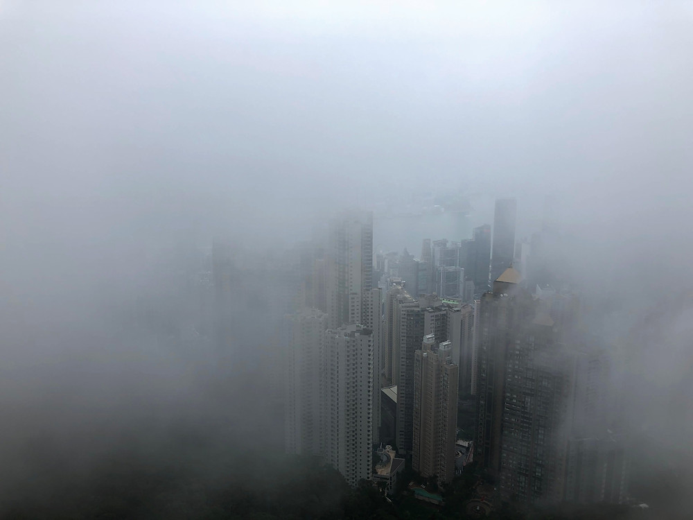 The fog slowly clears to present Hong Kong from Victoria Peak