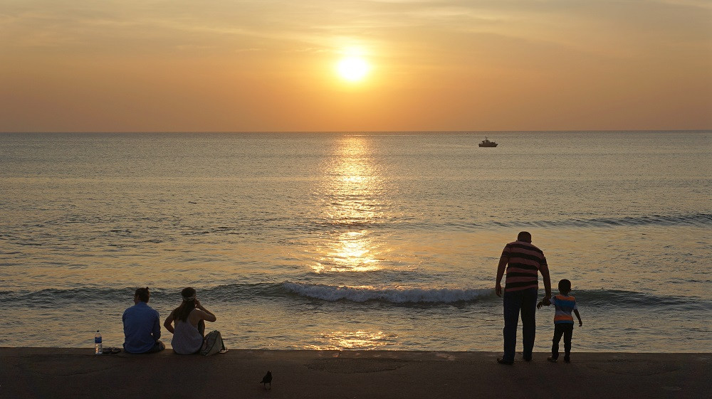 A moment to enjoy as the sun sets over Galle Face Green Promenade