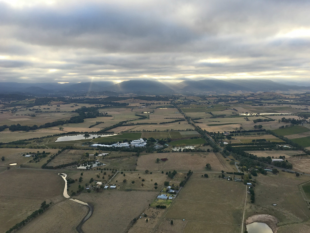 The sun trying to peek through the clouds above Yarra Valley