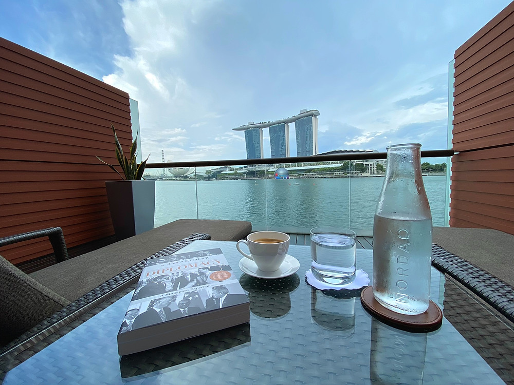 Fullerton Bay Hotel Premier Bay View Room - Enjoy a relaxing time reading in the comfort of your private sun deck
