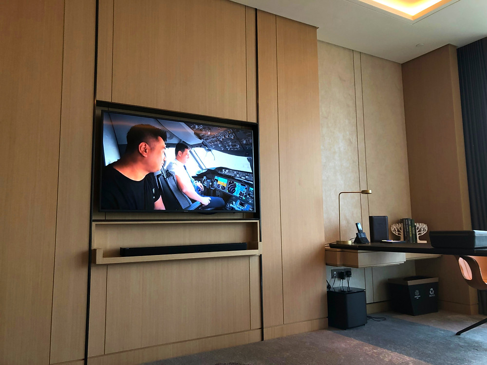 Prestige Suite - Relaxing and catching Sam Chui in action on the 55-inch television