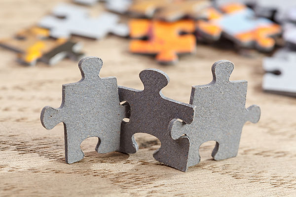 Three-Jigsaw-Puzzle-Pieces-on-Table-4952