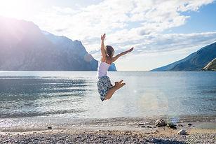 Woman jumping at lake.jpg