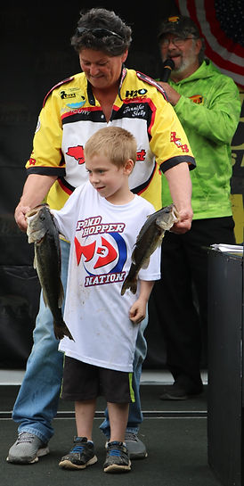 PHN boy holding fish.jpg
