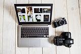Wedding photographer works on laptop scr