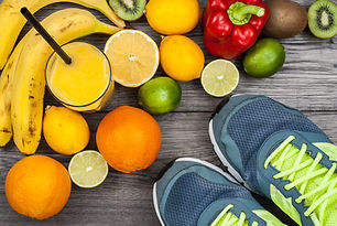 Fitness concept with fruit and trainers.