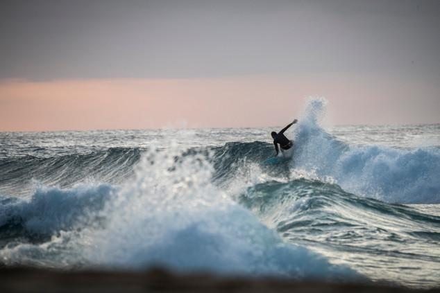 Unknown surfer at Pipeline, North Shore of Oahu