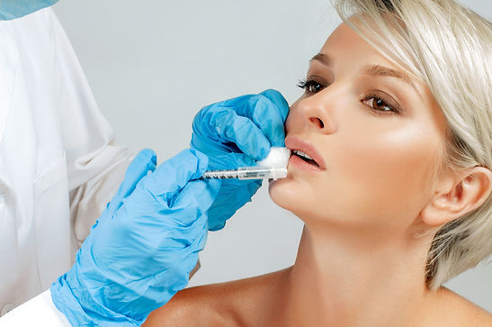 Beautiful girl receiving filler injectio