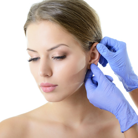 Young woman face with beauty treatment e