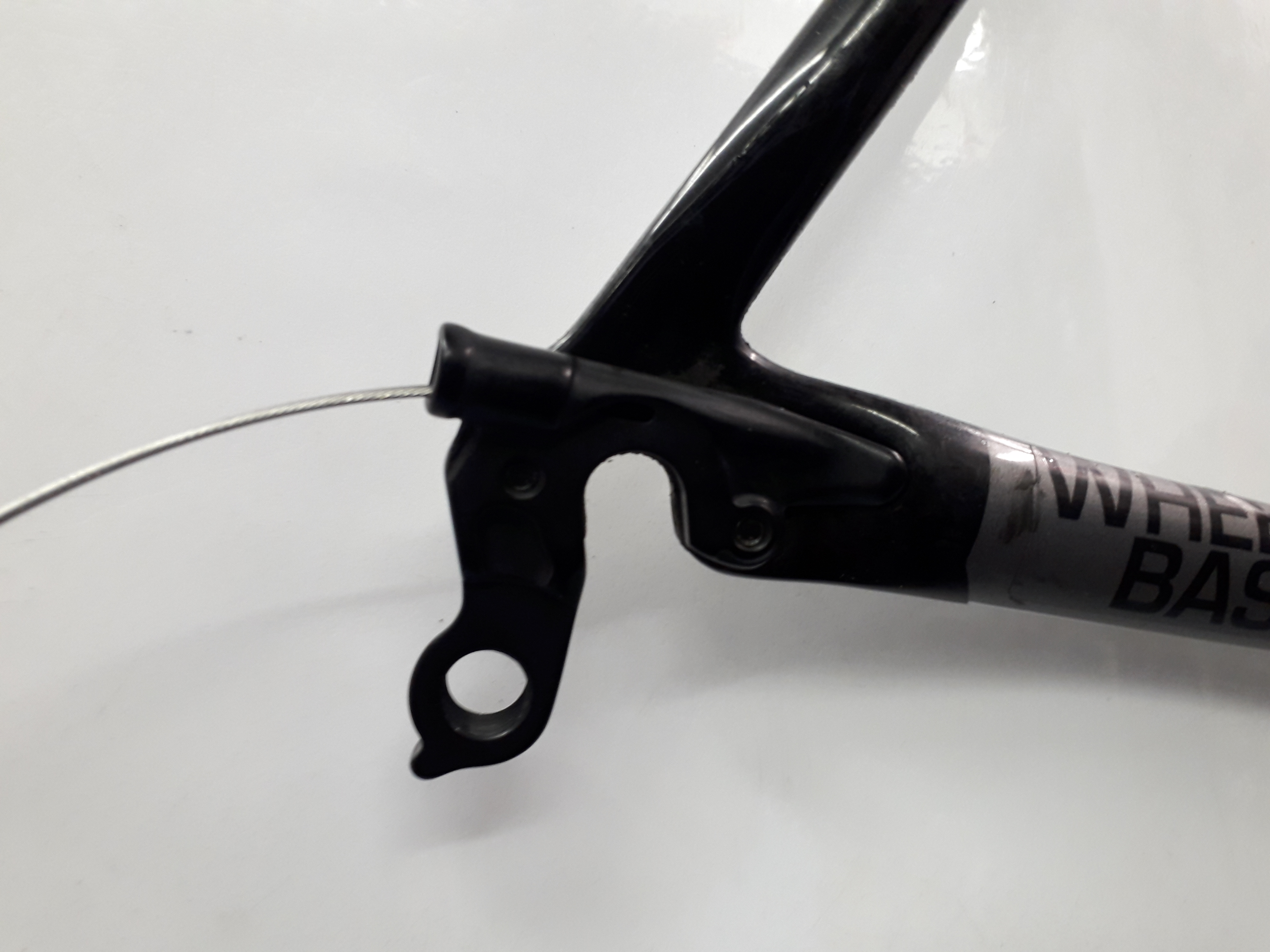 Hanger fitted with gear cable passing through it