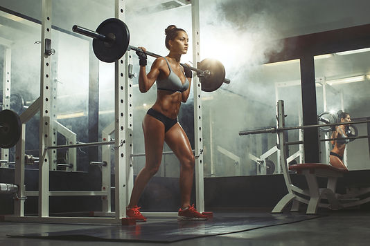 Woman lifting weight in gym.jpg