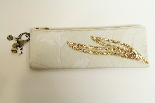 cream and gold fold over clutch