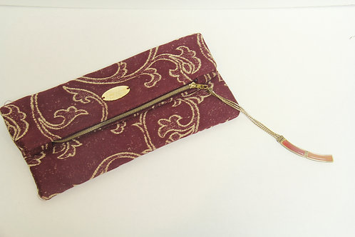 burgundy and gold fold over clutch