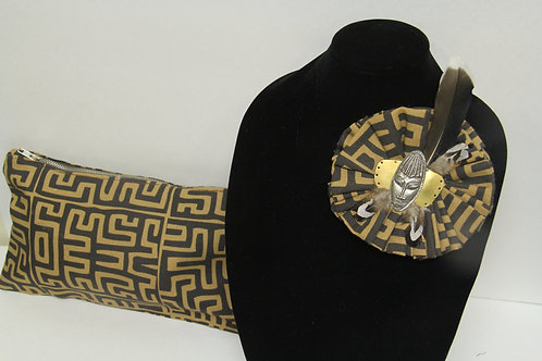 african inspired brooch with matching clutch