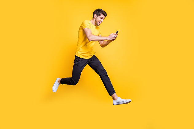 Full body photo of handsome guy jumping