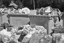 Dumpsters%20being%20full%20with%20garbag