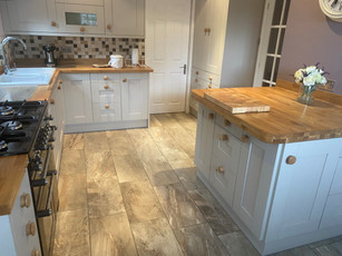 Up-cycled duck egg blue kitchen with new stone flooring