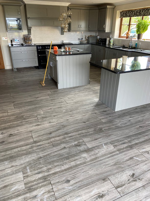 Up-cycled kitchen with a new modern floor