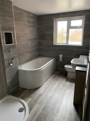 Bath taps placed in the wall to create a sleek finish