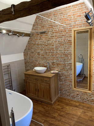Brick Effect Tiles, paired with wood effect tiles and large grey wall tiles