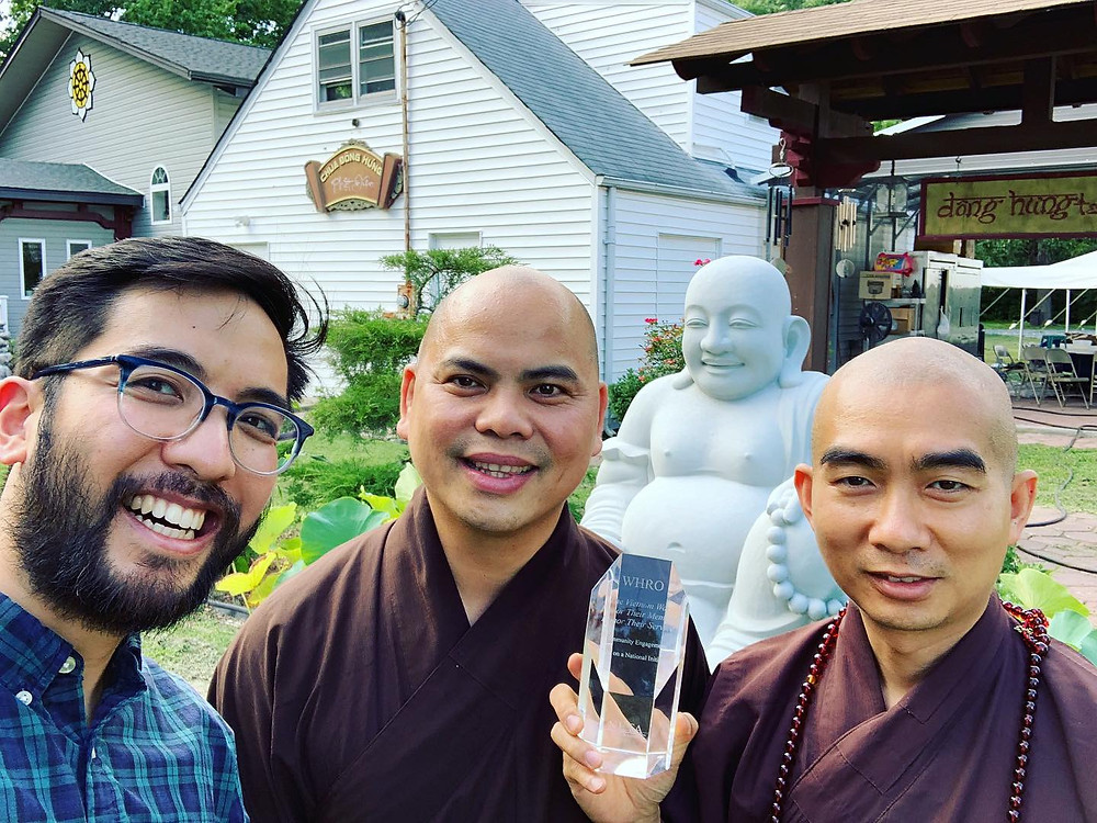 Me with some monks and the community engagement award.
