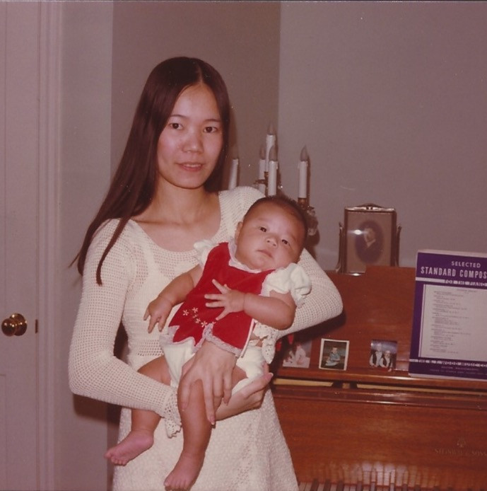 Phuong-Cac's as a baby in her mom's arms
