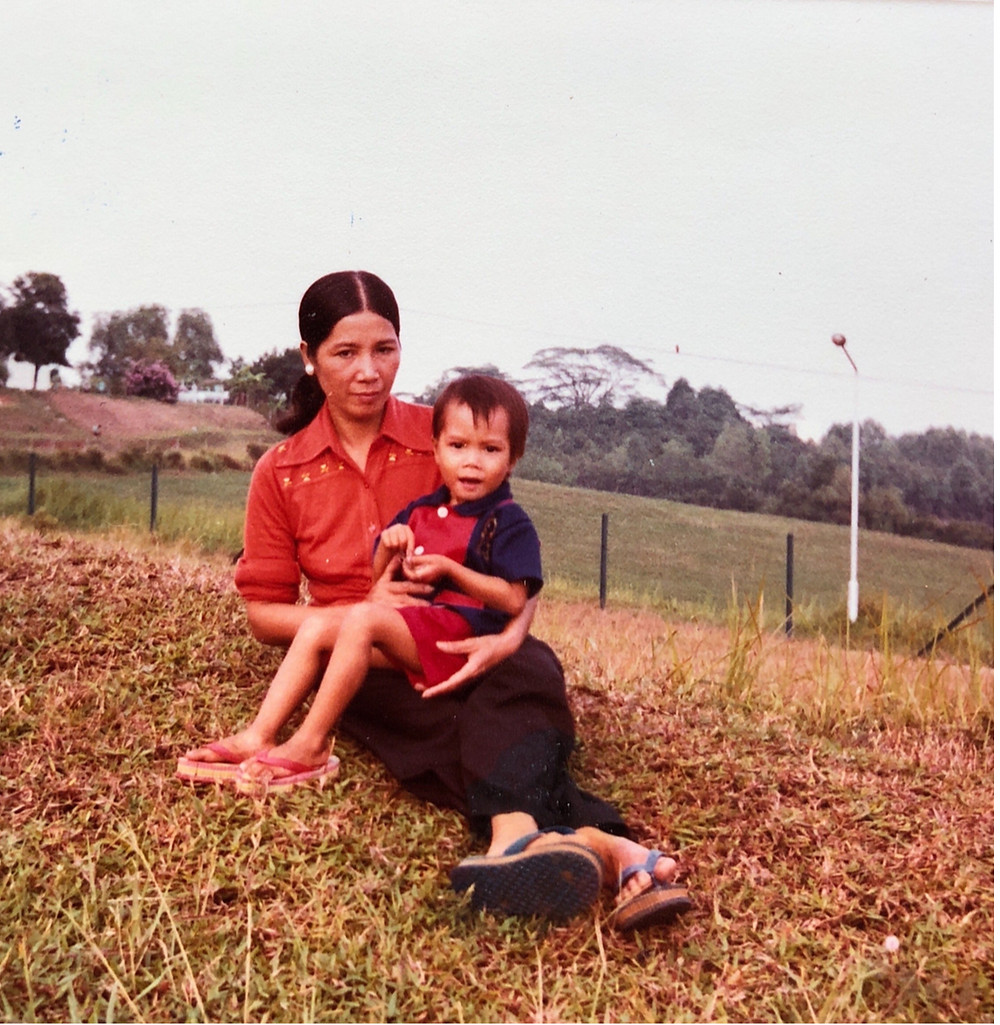 Mom and me at Singapore refugee camp in 1981