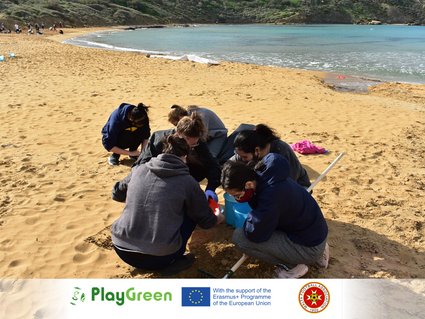 Work before pleasure: Malta FA and volunteers clean up the beach prior to a truly green match!