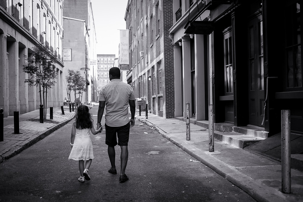 Dad and daughter walking in old city philadelphia