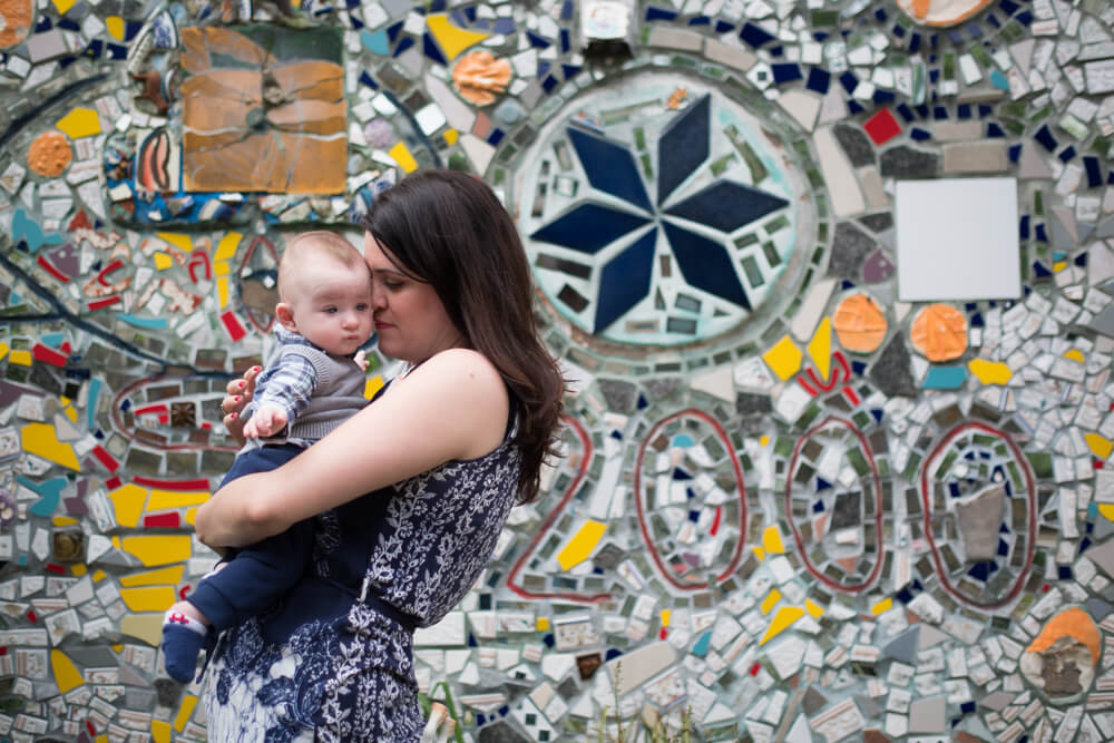 mom and baby in front of colorful wall