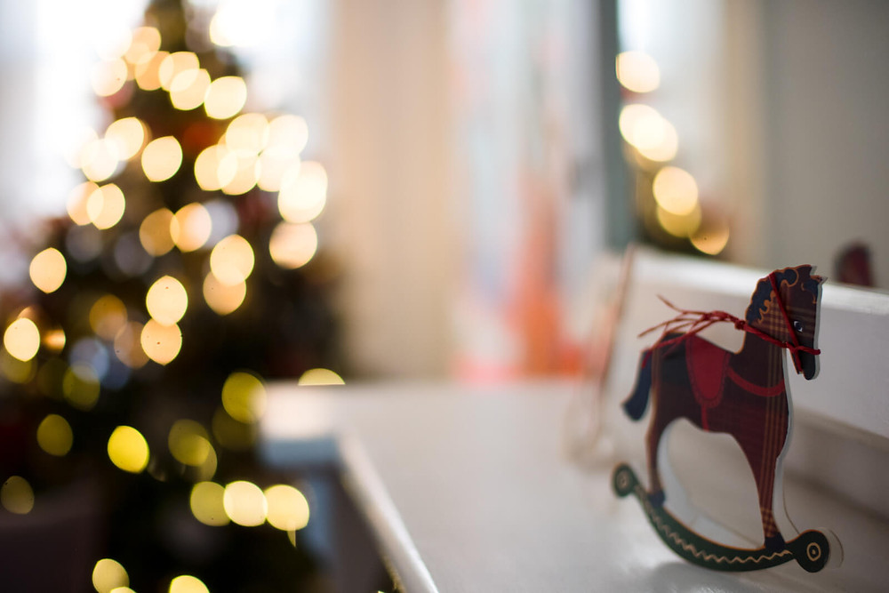 christmas horse and bokeh balls of christmas tree