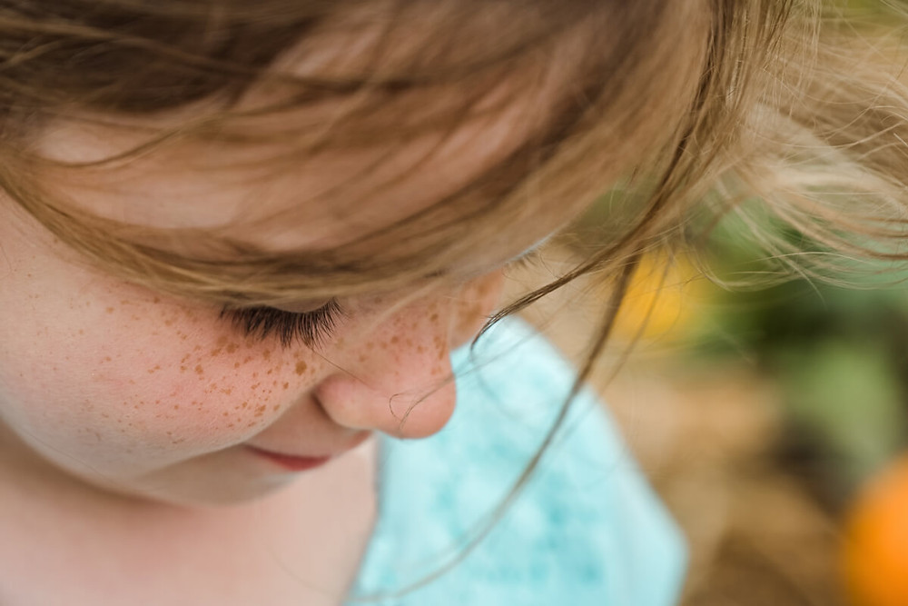 freckles and eyes lashes on little girl
