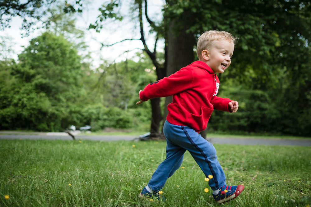 boy running on lemon hill