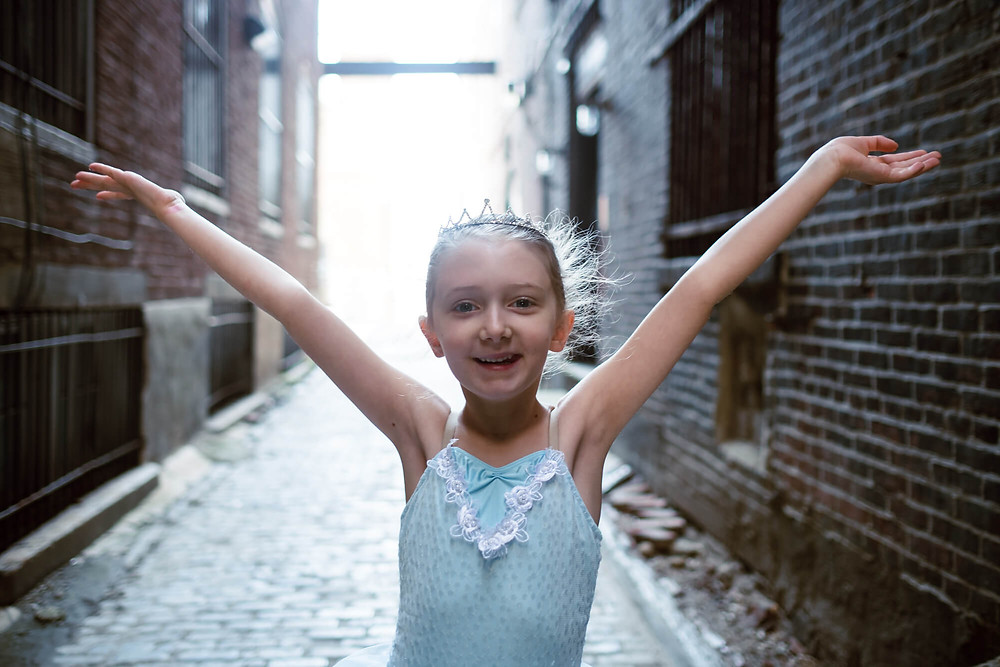 smiling ballerina in alley