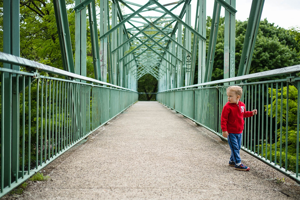boy crossing train bridge in fairmount