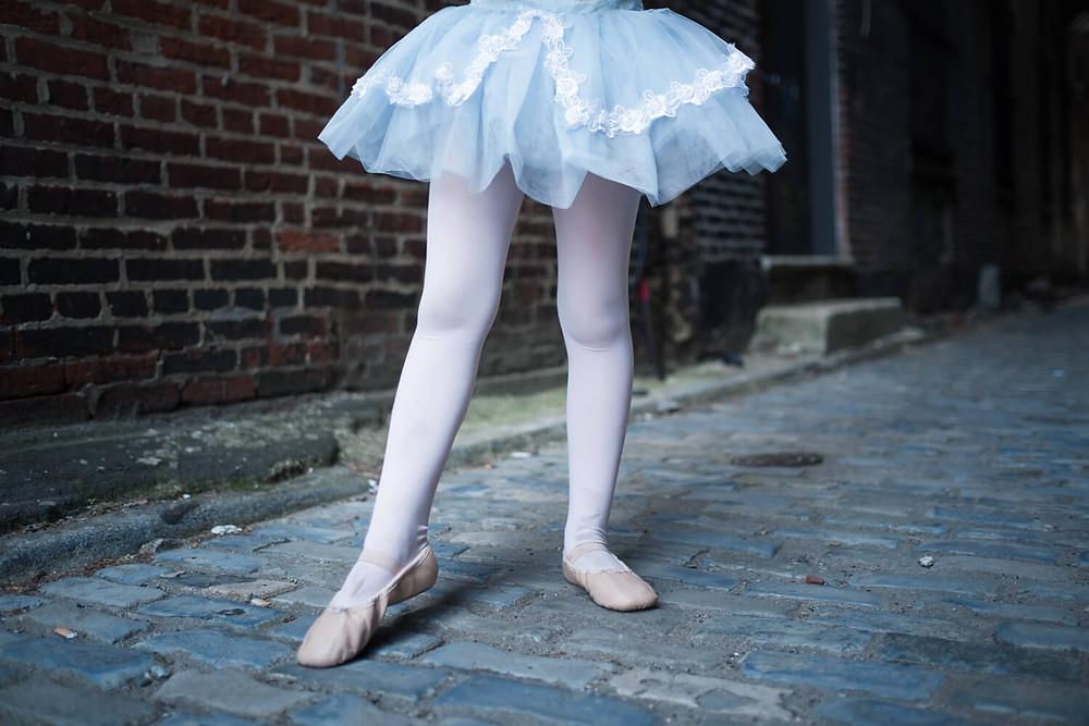 dancing legs in alley