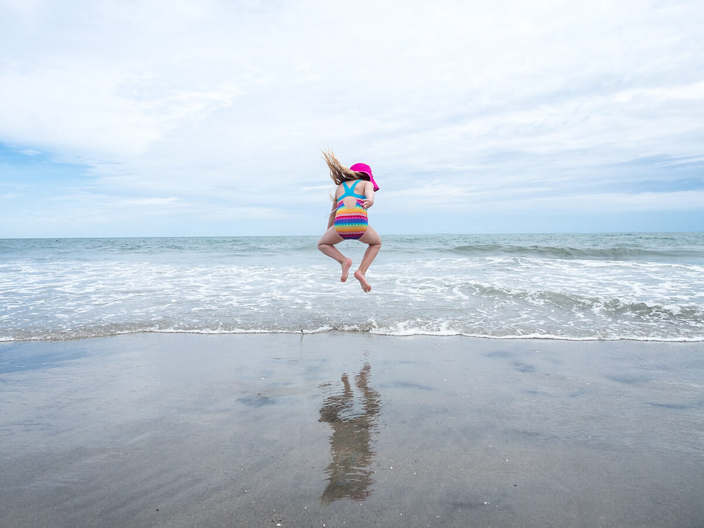 Child jumping on the beach in Atlantic City