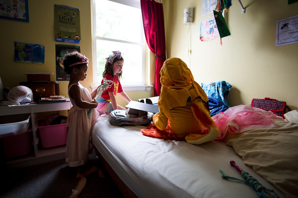 Documentary photography, children playing in a small room, philadelphia