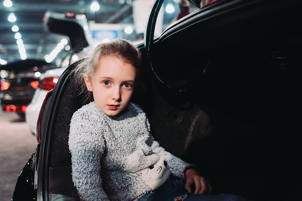 girl in trunk at the Philadelphia Auto Show
