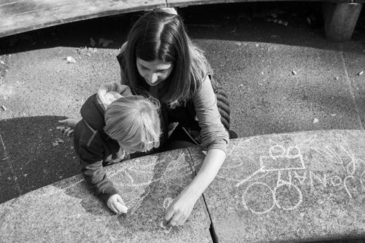 mom and son writing with chalk at rittenhouse square