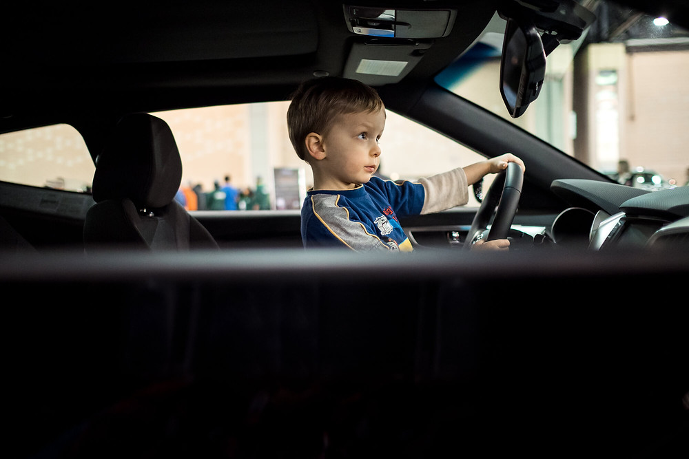 boy in car at the Philadelphia Auto Show