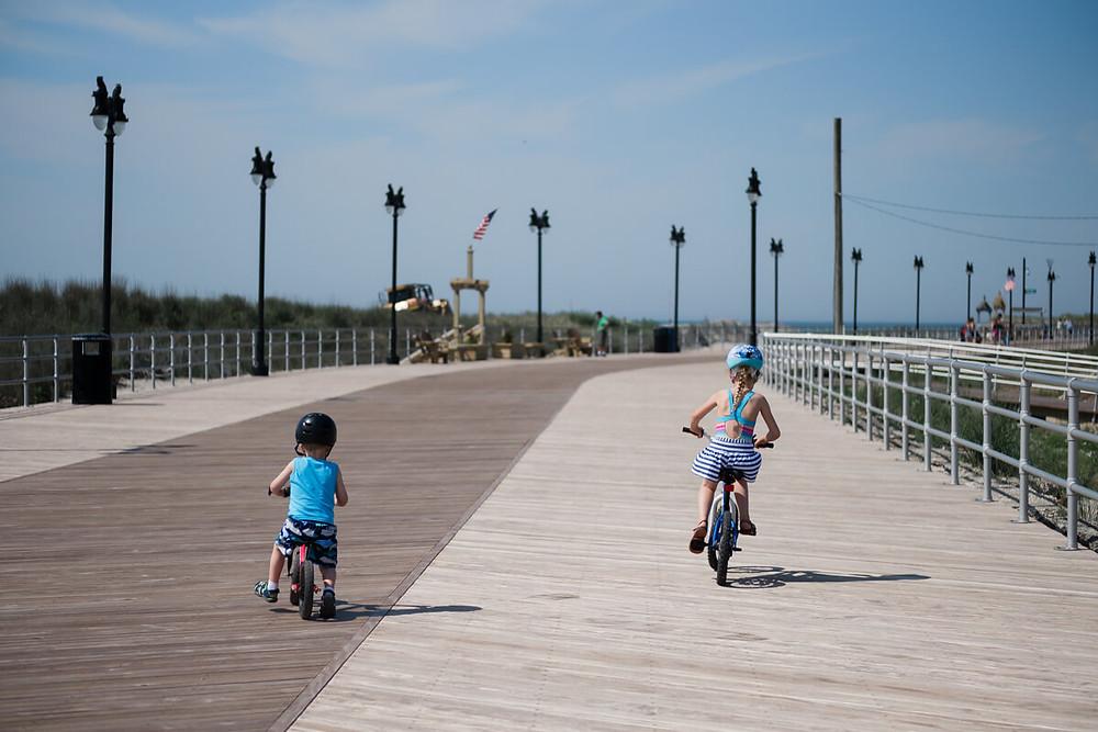 Children riding bikes on the boardwalk in Atlantic City